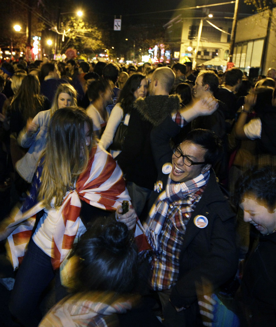Revelers celebrate early election returns favoring Washington state Referendum 74, which would legalize gay marriage, during a large impromptu street gathering in Seattle's Capitol Hill neighborhood, in the early hours of Wednesday, Nov. 7, 2012. The re-election of President Barack Obama and Referendum 74 drew the most supporters to the streets.  (Ted S. Warren / The Associated Press)