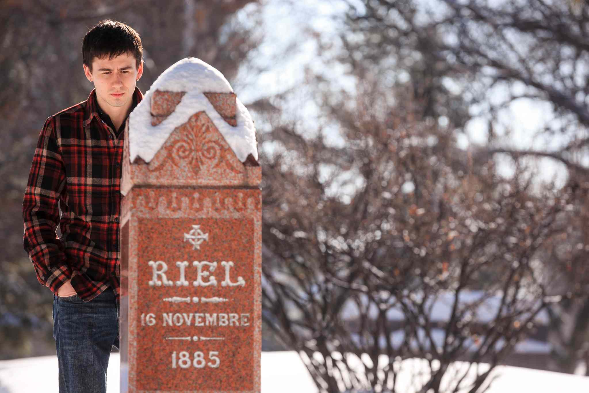 Ben Linnick quietly reflects at Louis Riel's marker at the St. Boniface Cathedral on Louis Riel day. Linnick said as a young Metis growing up in Flin Flon, Riel was a role model, and even more so now that he lives in Winnipeg.