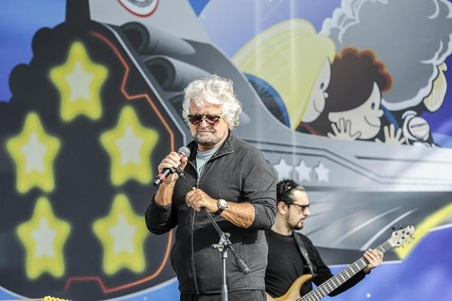 Leader of the Five Stars Moviment, Beppe Grillo performs on the stage during a meeting in Rimini, Italy, Saturday, Sept. 23, 2017 (Filippo Pruccoli/ANSA via AP)