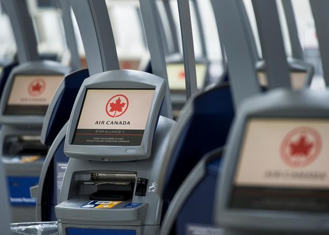 An Air Canada ticketing station is shown at Pearson International Airport in Toronto on Wednesday, April 8, 2020. THE CANADIAN PRESS/Nathan Denette