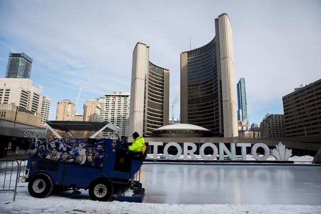 A Toronto city worker operates a Zamboni on the skating rink outside of Toronto City Hall after hearing that a tentative agreement has been reached between the City of Toronto and the city's outside workers, in Toronto, Saturday, Feb. 29, 2020. The Supreme Court of Canada will look at the legality of Ontario's decision to slash the size of Toronto's city council. THE CANADIAN PRESS/Cole Burston