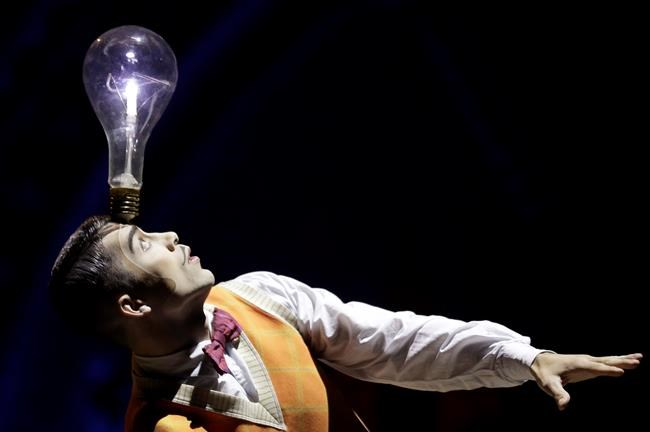 "A performer balances a lightbulb on his head during a preview of the Cirque Du Soleil production of ""Kurios - Cabinet of Curiosities"" in Sydney, Tuesday, Oct. 1, 2019. THE CANADIAN PRESS/AP/Rick Rycroft"