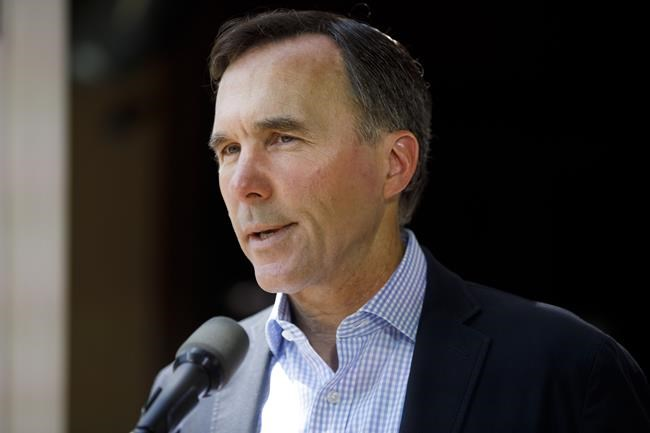 Finance Minister Bill Morneau speaks to media during a press conference in Toronto, Friday, July 17, 2020. In the wake of revelations that Morneau and his family participated in trips overseas sponsored by the WE organization, experts in the charitable sector say covering a donor's travel costs is not a usual practice for charities.THE CANADIAN PRESS/Cole Burston