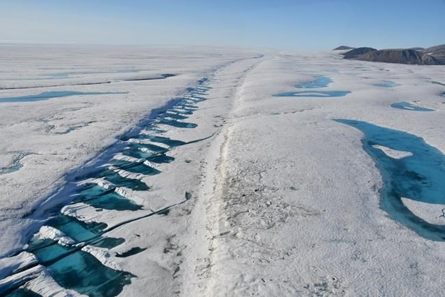 A rift in the Milne Ice Shelf on Ellesmere Island is shown in a 2019 handout photo. The Canadian Ice Service says a huge chunk has broken off Canada's last fully intact ice shelf on the northwest coast of Nunavut's Ellesmere Island. The Milne Ice Shelf is 40 per cent smaller after the split that began late last month. THE CANADIAN PRESS/HO-Carleton University-Derek Mueller MANDATORY CREDIT