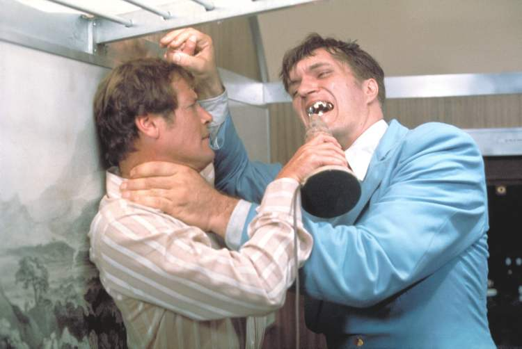 Richard Kiel, right, as Jaws and Roger Moore, as James Bond, fighting in the 1977 film, The Spy Who Loved Me. Those teeth could do some serious damage.