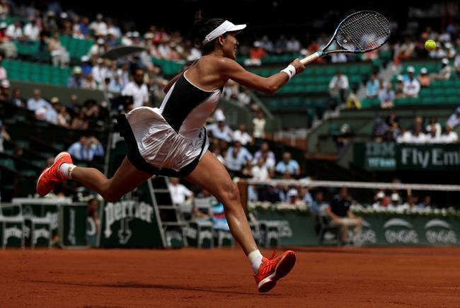 Muguruza breaks down in tears after lively clash with Mladenovic
