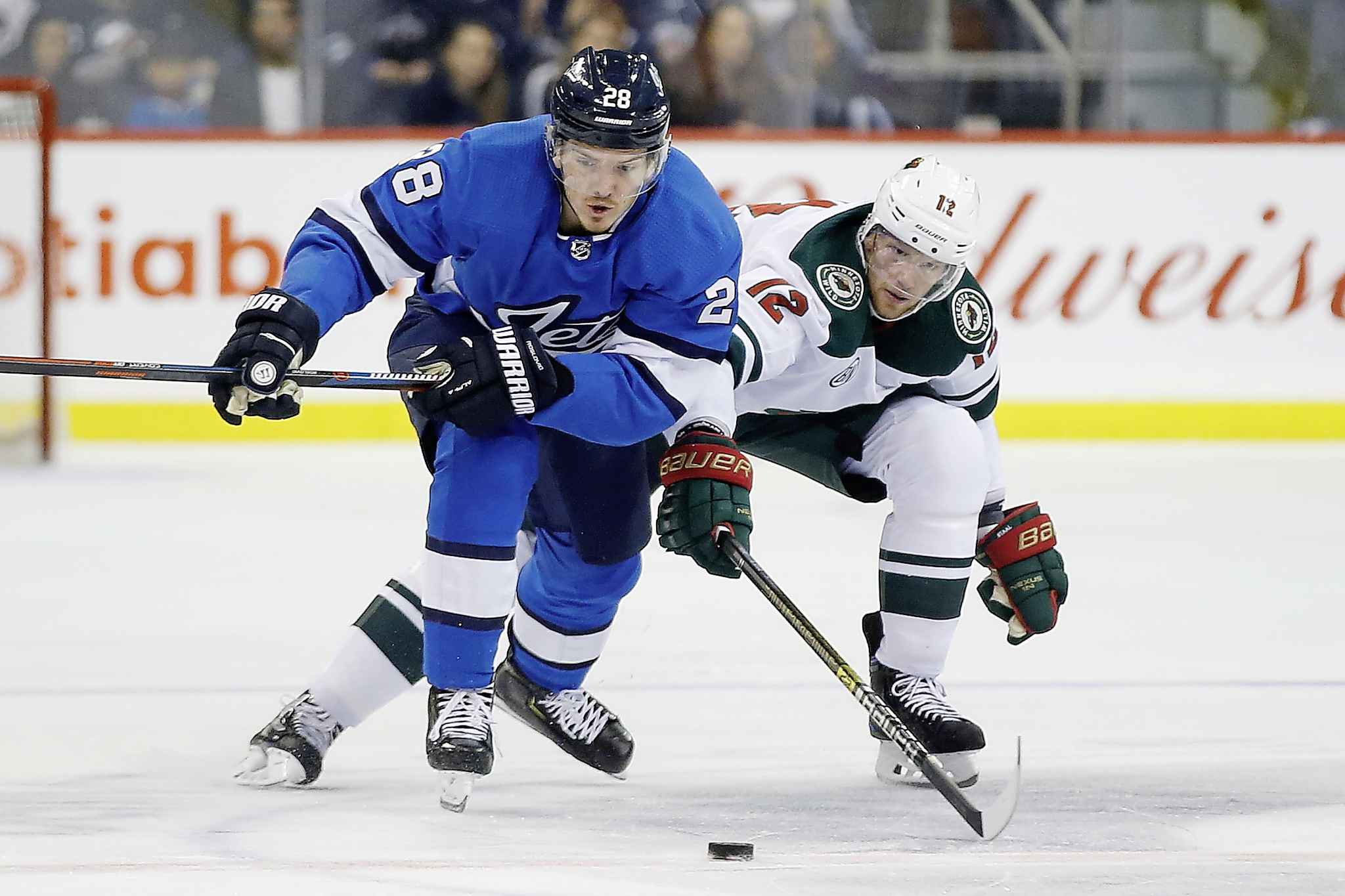 Winnipeg Jets' Jack Roslovic fends off Minnesota Wild's Eric Staal during game action in December. Despite being named the NHL's first star of the week after his first career hat-trick, the Jets' 2015 first-round draft pick also spent some time in the press box.