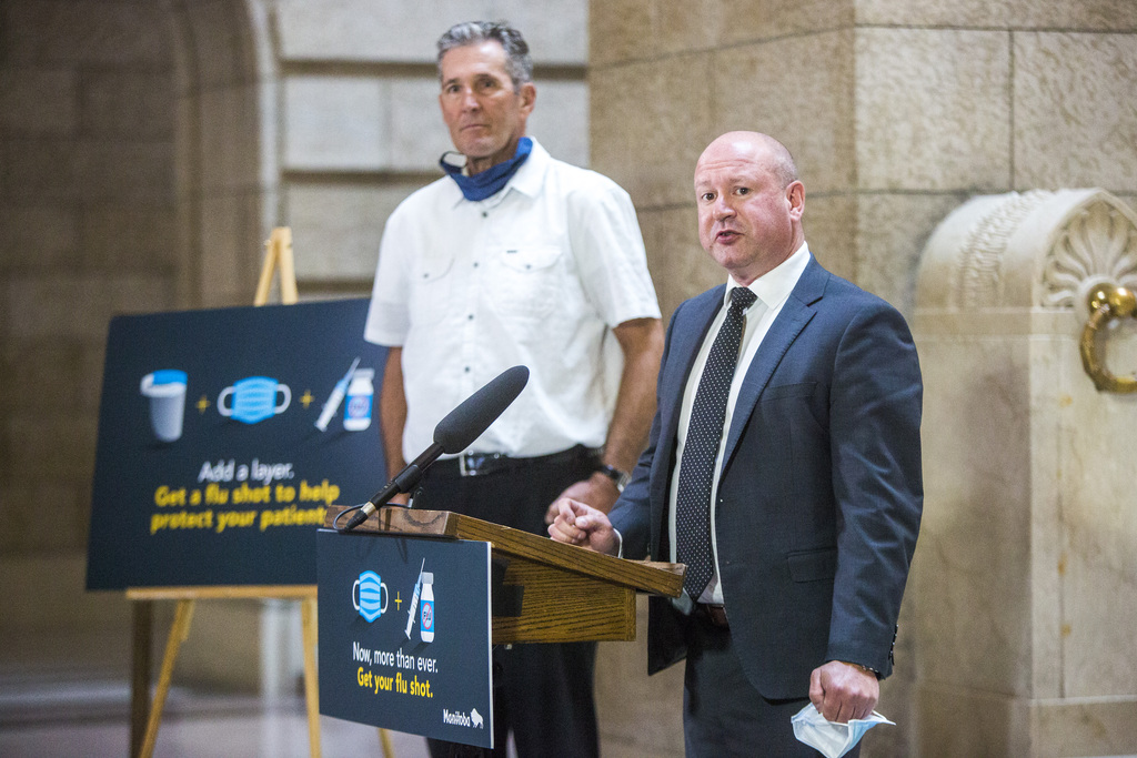 Chief provincial public health officer Dr. Brent Roussin (right) and Premier Brian Pallister at the Manitoba legislature, Thursday.