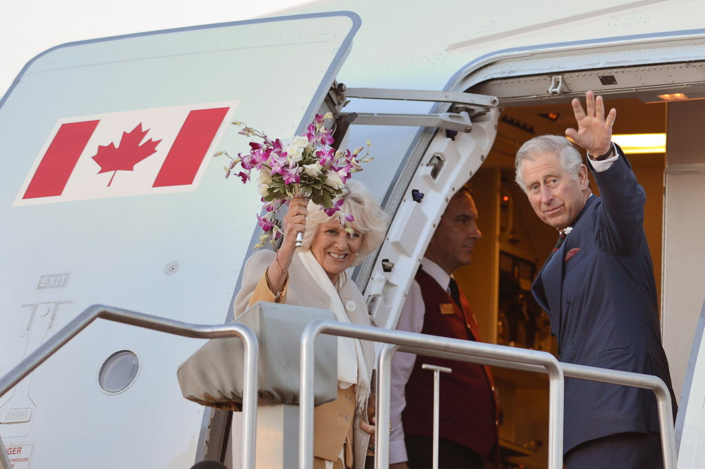 Prince Charles and his wife Camilla wave as they leave Winnipeg Wednesday.