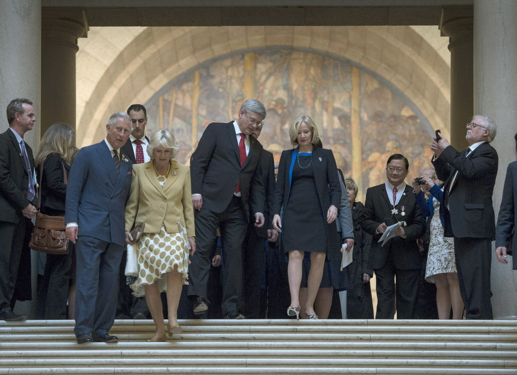 Prince Charles and his wife Camilla and Prime Minister Stephen Harper with his wife Laureen leave the Manitoba Legislature Wednesday.  (Paul Chiasson / THE CANADIAN PRESS)