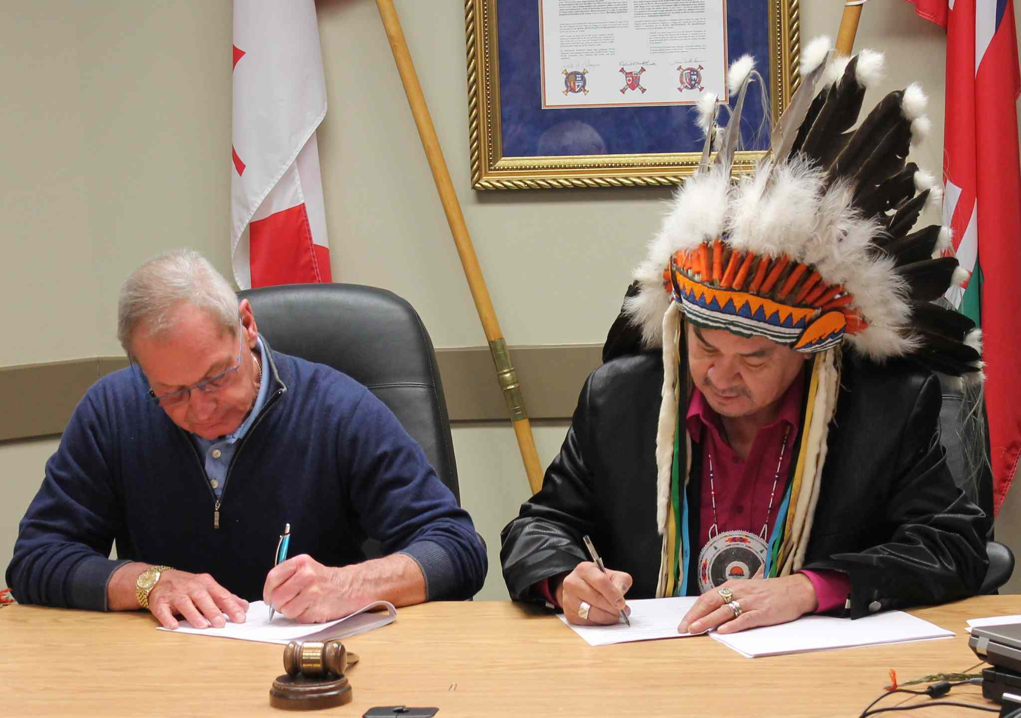Mayor Wilfred Taillieu, RM of Headingley, and Chief Morris Swan Shannacappo, Rolling River First Nation, sign a municipal development and services agreement.