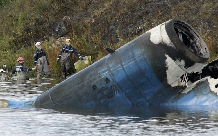 Rescuers work at the crash site of the Russian Yak-42 jet near the city of Yaroslavl on Sept. 7, 2011. The jet was carrying the Lokomotiv hockey team and crashed while taking off.