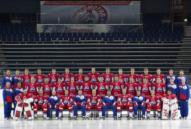 In this Sunday, Aug. 21, 2011 photo the Lokomotiv ice team poses in the Lokomotiv Arena in the city of Yaroslavl, located on the Volga River about 240 kilometres northeast of Moscow, Russia. (KHL archives)