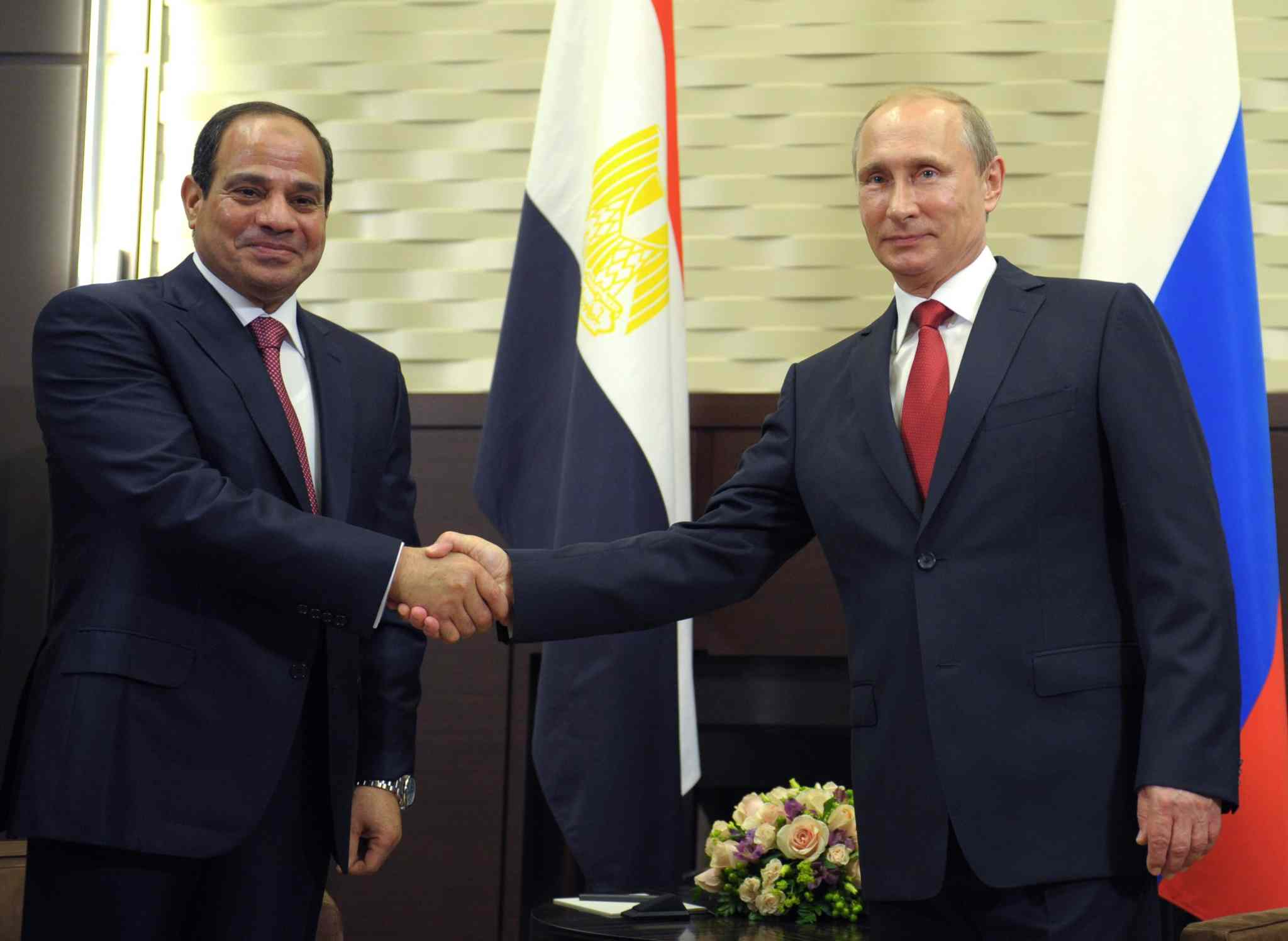 Russian President Vladimir Putin, right, and Egyptian President Abdel-Fattah el-Sissi shake hands during a meeting in the Russian Black Sea resort of Sochi, Russia, Tuesday, Aug. 12, 2014.