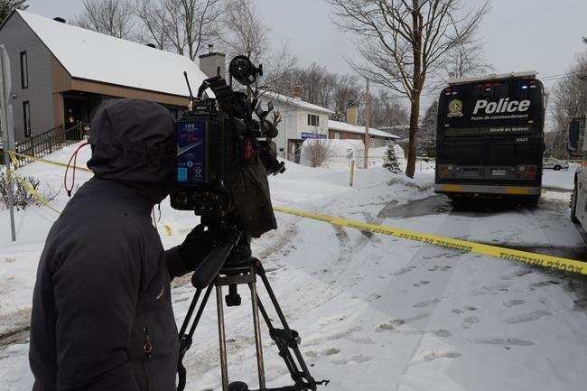 A camera operator films the scene outside a home in Mascouche, Que., Thursday, Jan.16, 2020. Quebec provincial police are investigating the killing of a woman in her 30s inside a home in Mascouche. THE CANADIAN PRESS/Ryan Remiorz