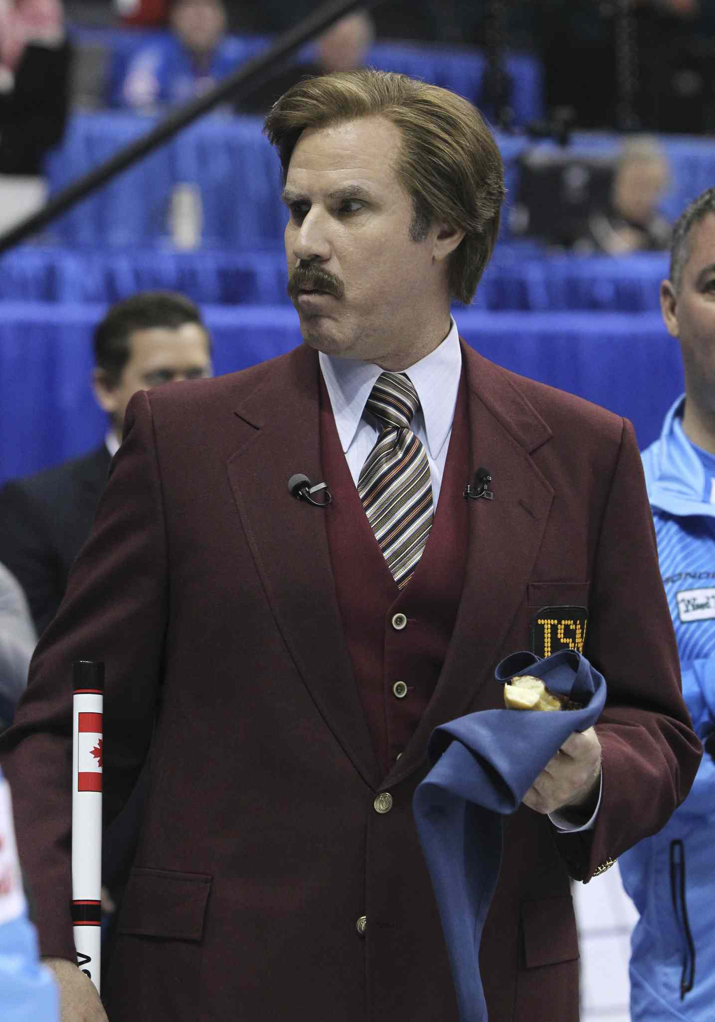 Ron Burgundy cradles a doughnut at Roar of the Rings.