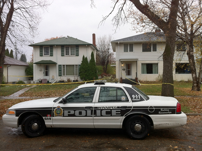 RiverHeightsscene2 PHOTO: A police crime scene vehicle is parked in front of the luxury ...