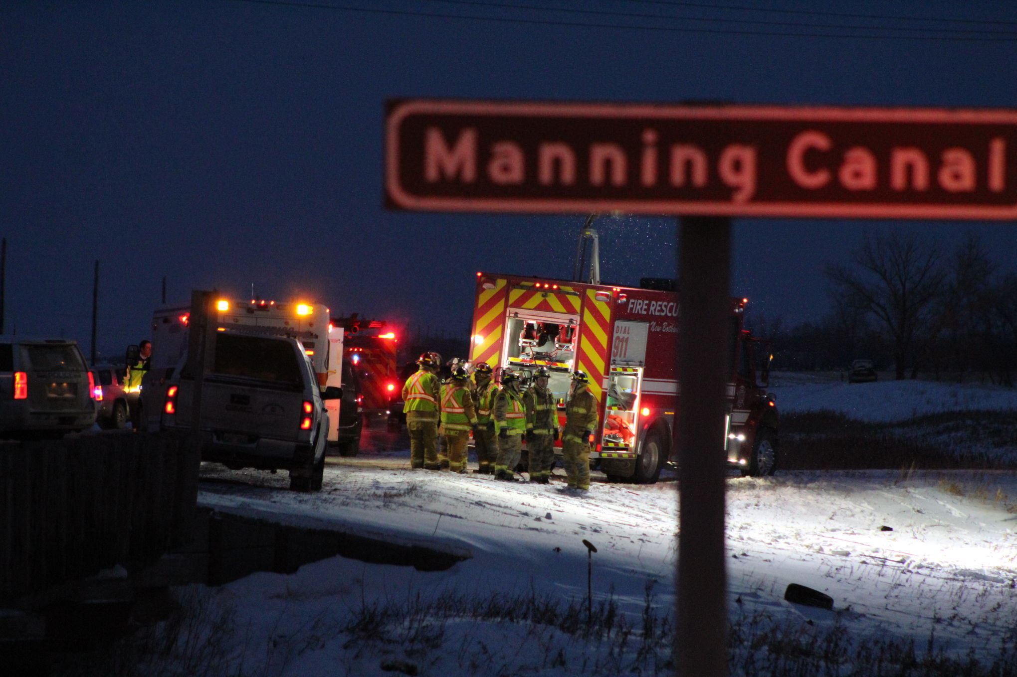Hanover Fire Department members congregate at the scene of a fatal single-vehicle rollover on Provincial Road 311 Thursday afternoon.