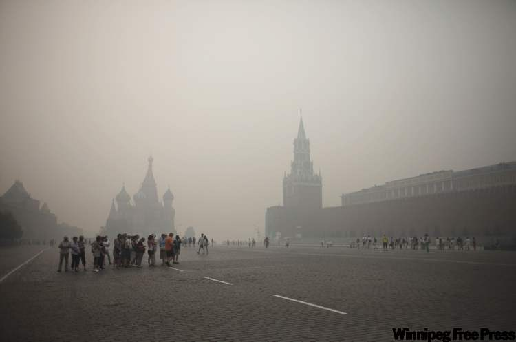 Tourists in Moscow walk along Red Square earlier this week wearing face masks amid a thick blanket of smog, caused by hundreds of wildfires.