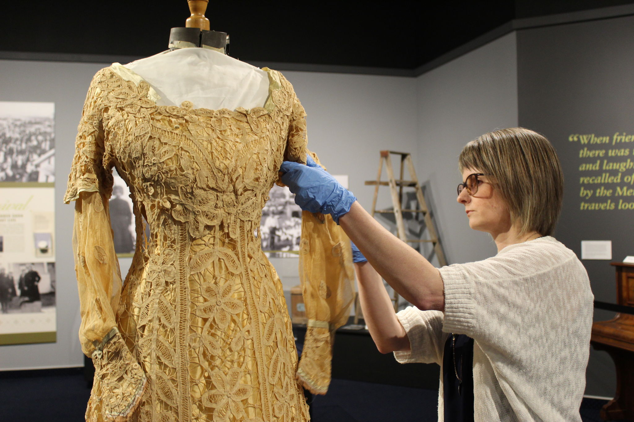 Senior curator Andrea Dyck adjusts a lace dress featured prominently in The Russländer, a new exhibit that has opened in the Gerhard Ens Gallery at Mennonite Heritage Village. The dressed belonged to Maria Heese, who settled in Grunthal.