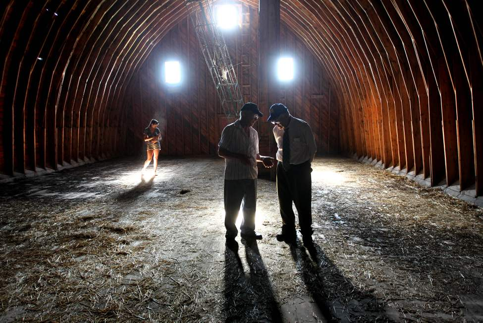 My favourite picture of 2013 can be traced back to my roots.  Earlier this year I visited my family farm in southwestern Manitoba to celebrate my father's milestone 80th birthday. The scene in this photo is set in a loft of a large barn built by the skillful hands of my grandfather.  My father and uncle take centre stage as they stand in the middle of the loft while my daughter cradles a young kitten behind them.  As the two men casually reminisce about the past, their shadows grow taller as a cast of light shines like a spotlight on the emerging generation behind them. Though the eye is drawn to the light shining in the background, the viewer's attention is quickly pulled foreword to the shadowy figures in the foreground. This haunting image illustrates to me how the generation that is to come serves its future well when it values and learns from the experience and wisdom held in the roots of its past. Go to this link to watch Ruth's Uncle Herman perform the