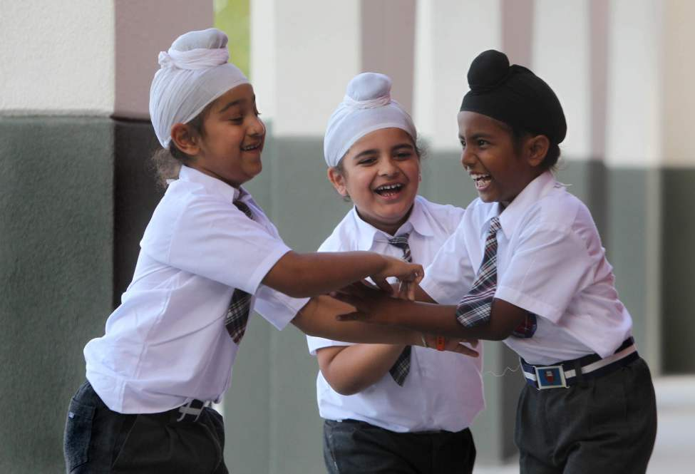 Young Sikh students have some fun as they goof around outside their school at the Punjab Cultural Centre. September 12, 2013  Ruth Bonneville / Winnipeg Free Press