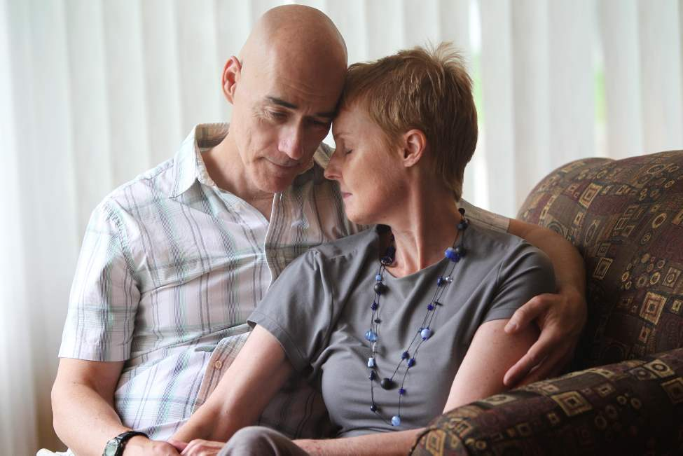 Winnipeg Free Press columnist Lindor Reynolds shares a tender moment with her husband Neil at their home after recently being diagnosed with brain cancer. July 10, 2013 Ruth Bonneville / Winnipeg Free Press