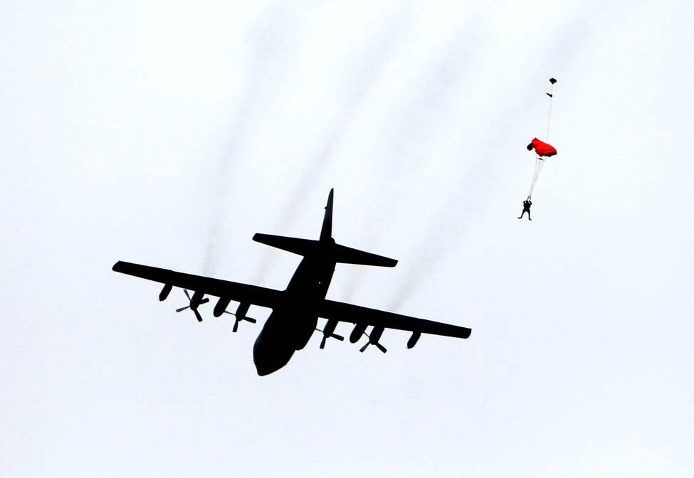 A SAREX Search and Rescue member parachutes out of a hercules airplane into Lake Winnipeg during mission near Gimli harbour. 
