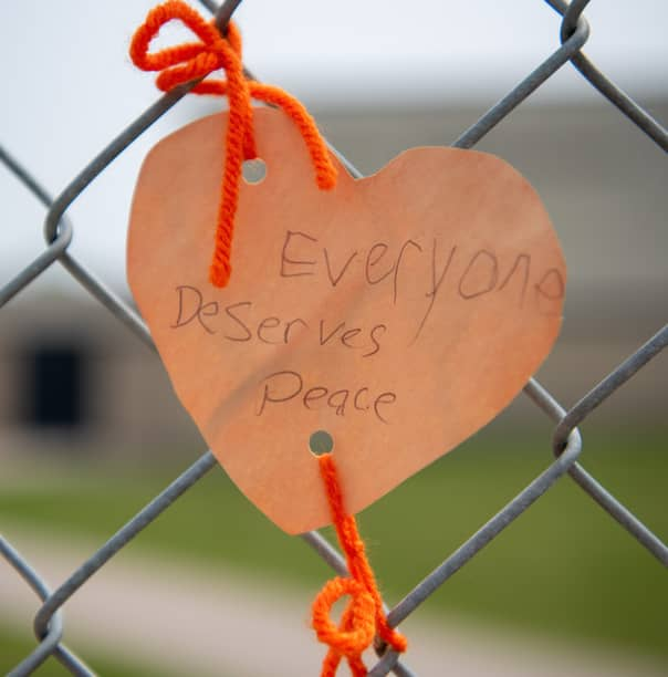 ALEX LUPUL / WINNIPEG FREE PRESS    Orange hearts tied to the fence outside of  Ryerson School are photographed in Winnipeg on Tuesday, June 8, 2021. The hearts contain messages, written by staff and students, explaining actions they will take to assist the indigenous community. The elementary school is named after Egerton Ryerson, who is considered a chief architect of Canada's residential school system.