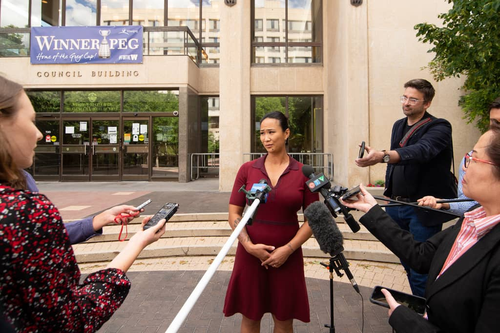 City Councillor for Point Douglas, Vivian Santos, answers media questions about her resignation from the Winnipeg Police Board outside City Hall Tuesday.