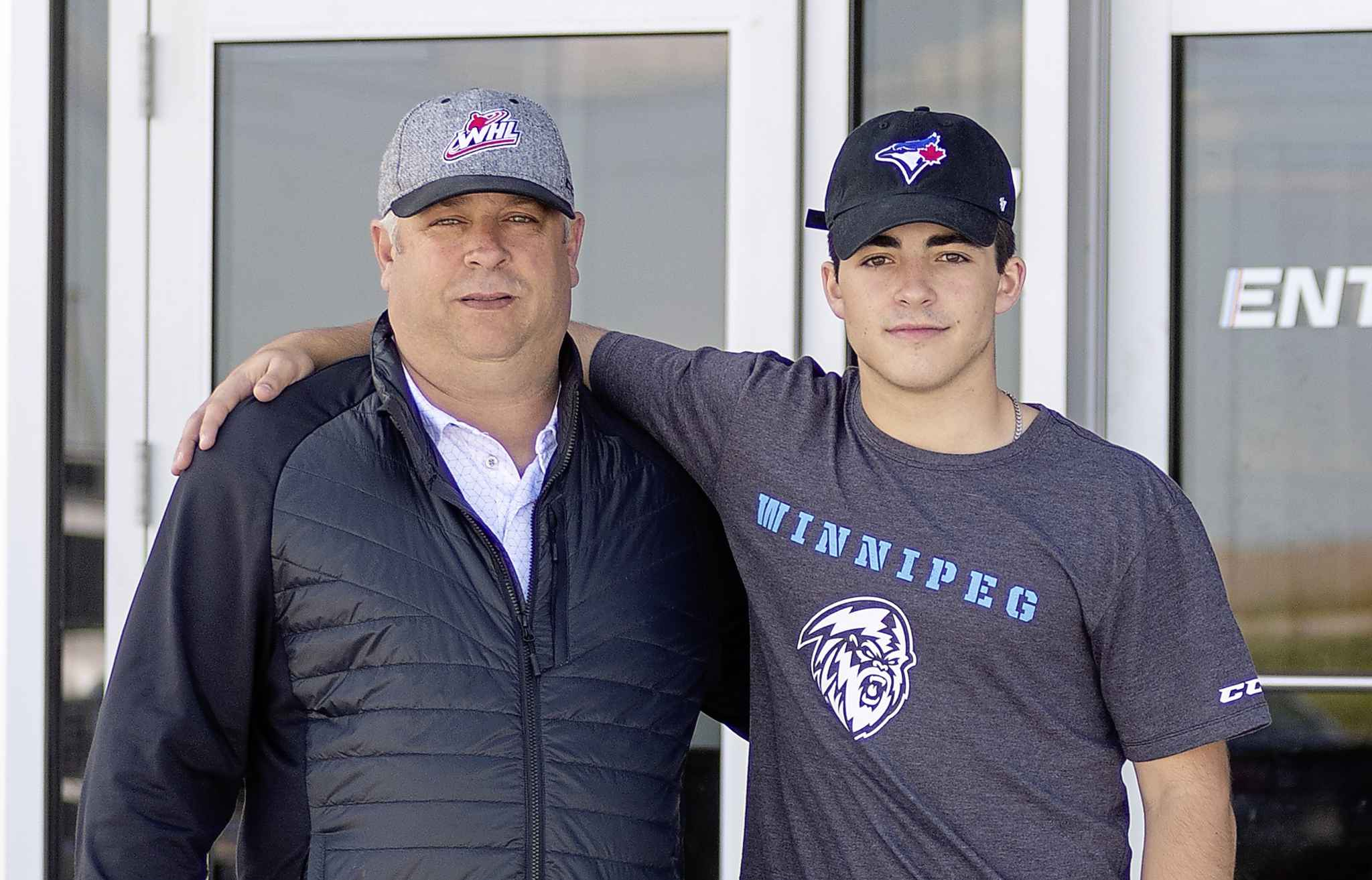 The Savoies, dad Scott, left, and his son Matt visit the Rink Training Centre Wednesday afternoon.
