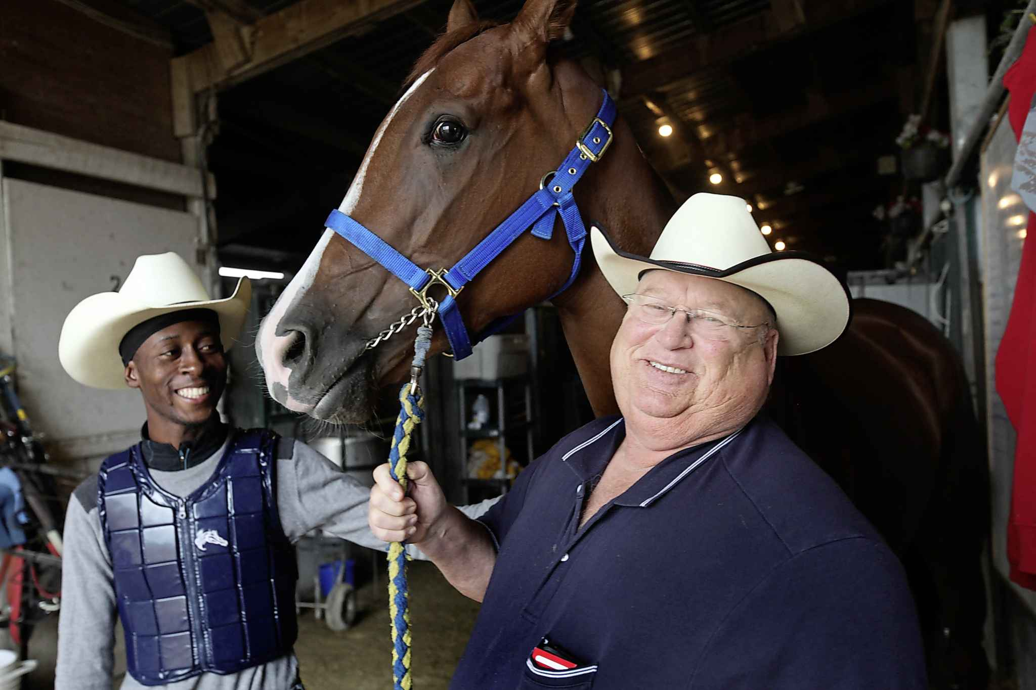 Horse Trainer Ardell Sayler (right) with horse Girl Boss and jockeyTyrone Nelson in the stables at Assiniboine Downs in 2016. Sayler, a legend in the local horse racing community, died Saturday from what's believed to be a heart attack at age 66.