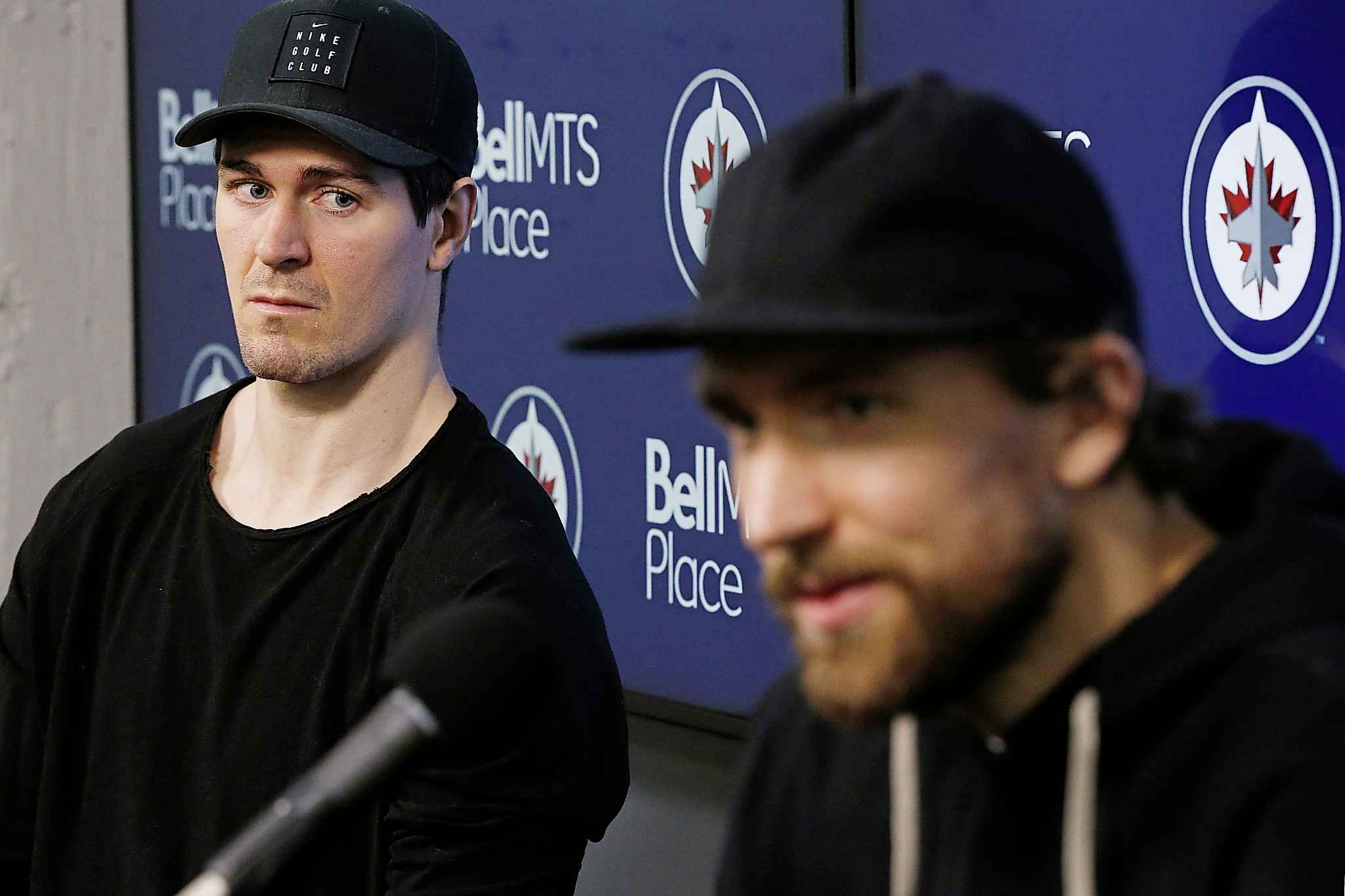 Winnipeg Jets' Mark Scheifele, left, sat silently as Blake Wheeler spoke to the media at the team's season-closing press conference after losing in the first round of the NHL playoffs to the St. Louis Blues.