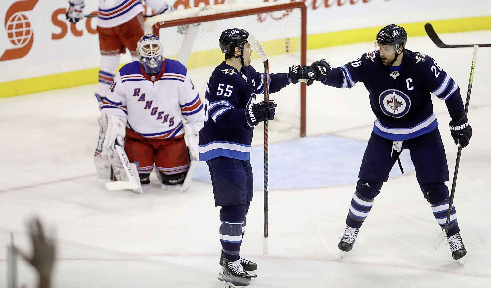 Scheifele, left, with linemate, right wing Blake Wheeler. Wheeler's five-year contract extension will kick in next season, paying him $8.25 million a year and pushing Scheifele even further down the list of top salaries on the Jets.