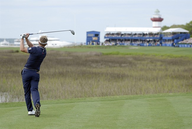 Luke Donald tees off on the 18th hole during the final of the RBC Heritage on Sunday, April 20, 2014, at Harbour Town Golf Links in Sea Pines on Hilton Head Island S.C. (AP Photo/The Island Packet, Delayna Earley)