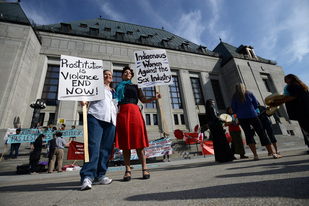 Protesters rally in 2013 at the Supreme Court in Ottawa where Canada's prostitution laws were challenged and eventually struck down.