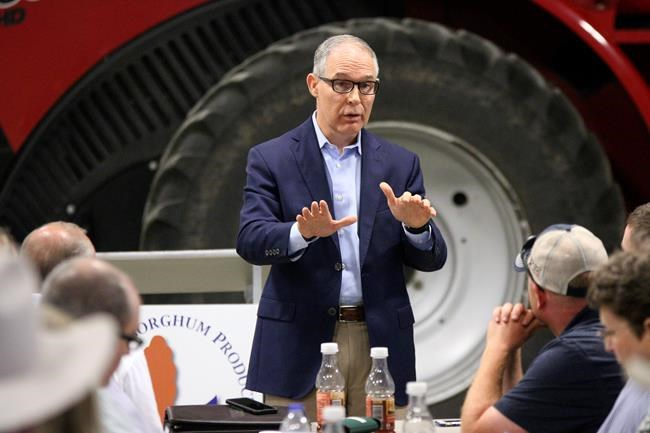 Environmental Protection Agency Administrator Scott Pruitt addresses farmers during a forum at a farm near Reliance, S.D. Farmers and ethanol producers gave Pruitt a rough reception in South Dakota, accusing him of undermining the industry that's a key part of the state's economy. (Ellen Bardash/The Daily Republic via AP)