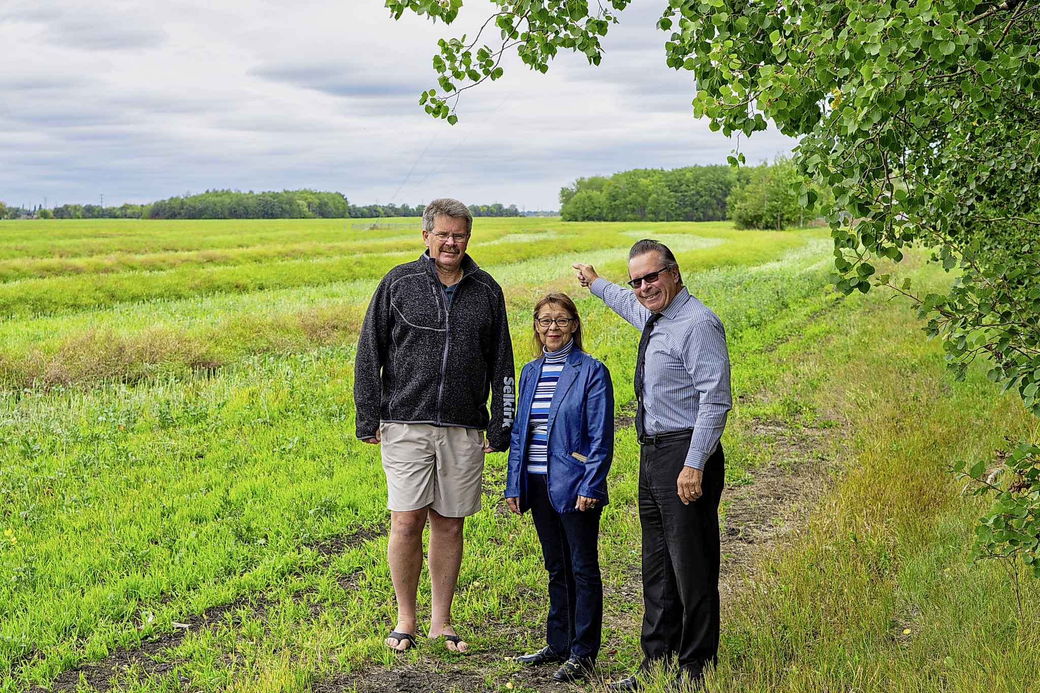 Selkirk city councillor Kelly Cook, (left to right) Deputy Mayor Darlene Swiderski, and Mayor Larry Johannson in front of the land on the west end of the city which will be developed over the next three decades.