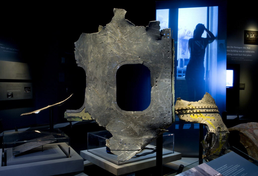 A piece of airplane damaged in the attacks of September 11, 2001, is displayed at the New York museum.