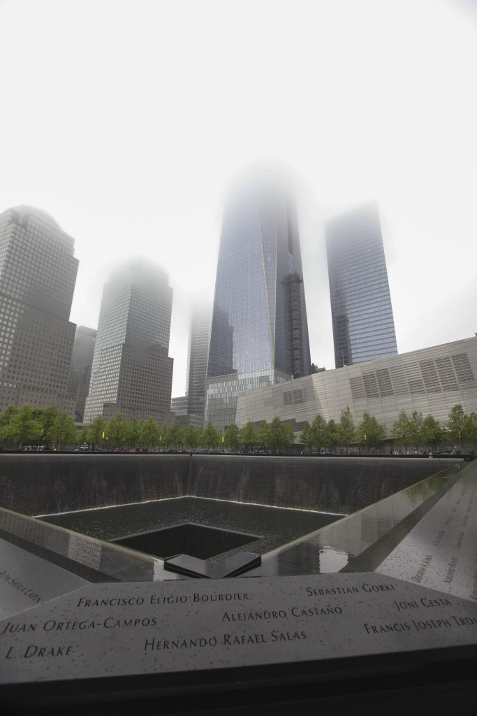 Fog looms lover the memorial plaza during the dedication ceremony for National September 11 Memorial Museum in New York, Thursday.