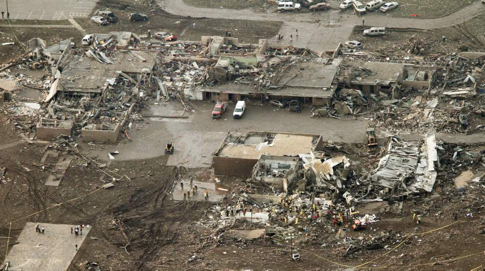 This aerial photo shows damage to the Plaza Towers Elementary School after massive tornado hit Moore, Okla., Monday.  (Steve Gooch / The Associated Press)