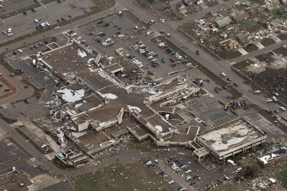 This aerial photo shows damage to Moore Medical Center after it was hit by a massive tornado in Moore, Okla., Monday. (Steve Gooch / The Associated Press)