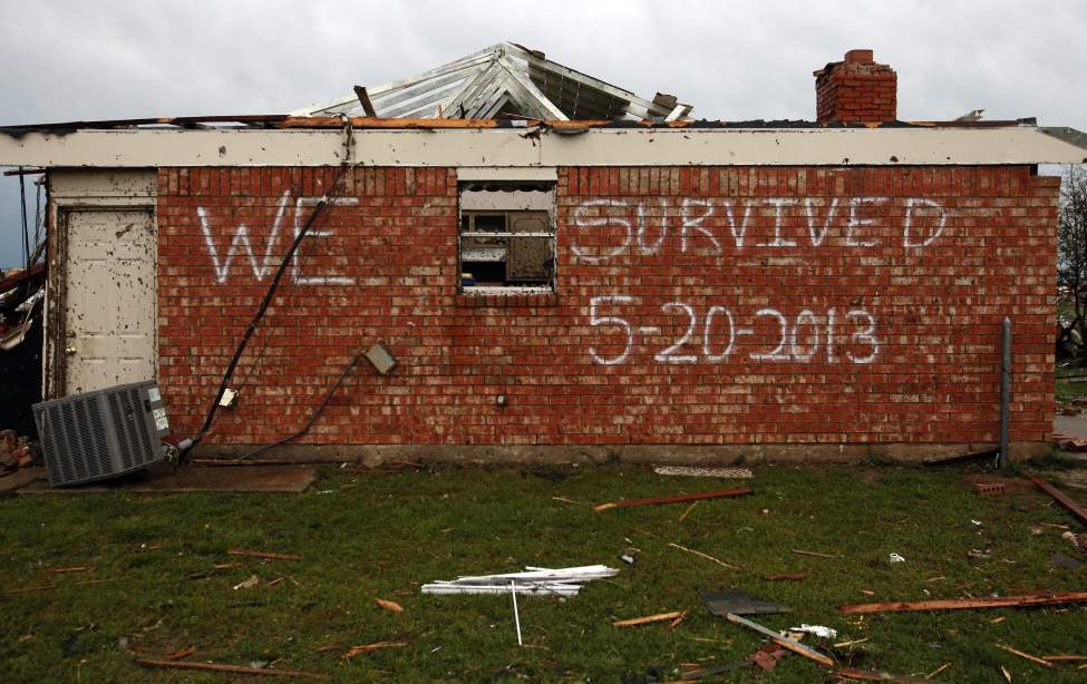 A survivor's message is left on the side of a home on Heather Lane in Moore, Okla., on Tuesday. (Brad Loper / The Dallas Morning News)