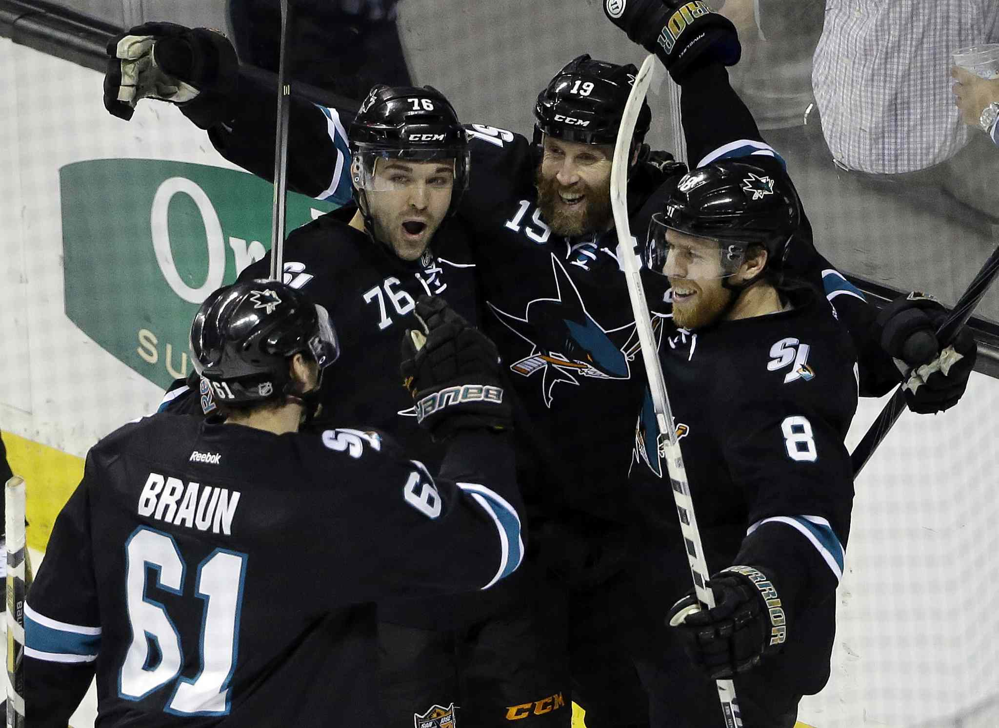 San Jose Sharks' Joe Pavelski (8) celebrates his goal with teammates during the third period of an NHL hockey game against the Winnipeg Jets on Thursday. San Jose won 1-0.