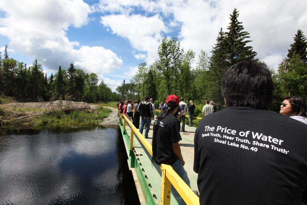 Residents of Shoal Lake 40 First Nation participate in a special ceremony held Wednesday to mark the 100th anniversary of the flooding of their land to provide water for the City of Winnipeg.   (Ruth Bonneville / Winnipeg Free Press)