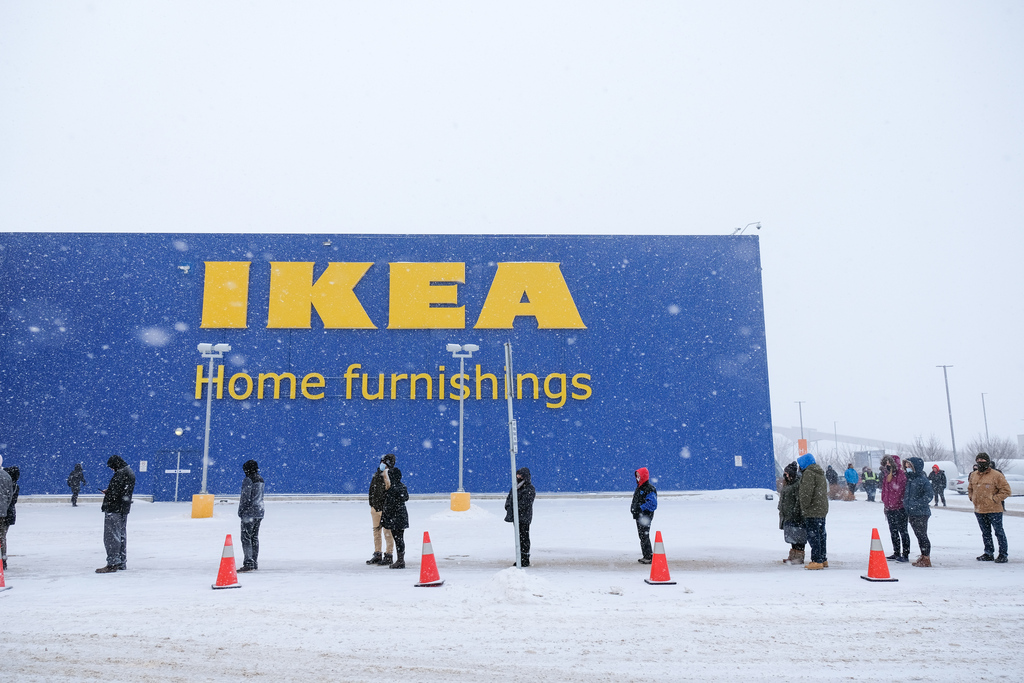 The line of shoppers wrapped around the building at IKEA on the first day of eased retail restrictions, Saturday.