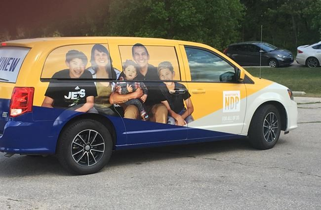 Manitoba NDP Leader Wab Kinew revealed his campaign van for the Sept. 10 provincial election, Wednesday, Aug.7, 2019 in Winnipeg. Kinew says his party's campaign will fpocus largely on health care. THE CANADIAN PRESS/Steve Lambert