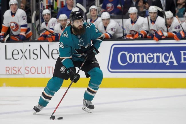 San Jose Sharks defenseman Brent Burns (88) controls the puck during the first period against the New York Islanders in an NHL hockey game in San Jose, Calif., Saturday, Nov. 23, 2019. (AP Photo/Jeff Chiu)