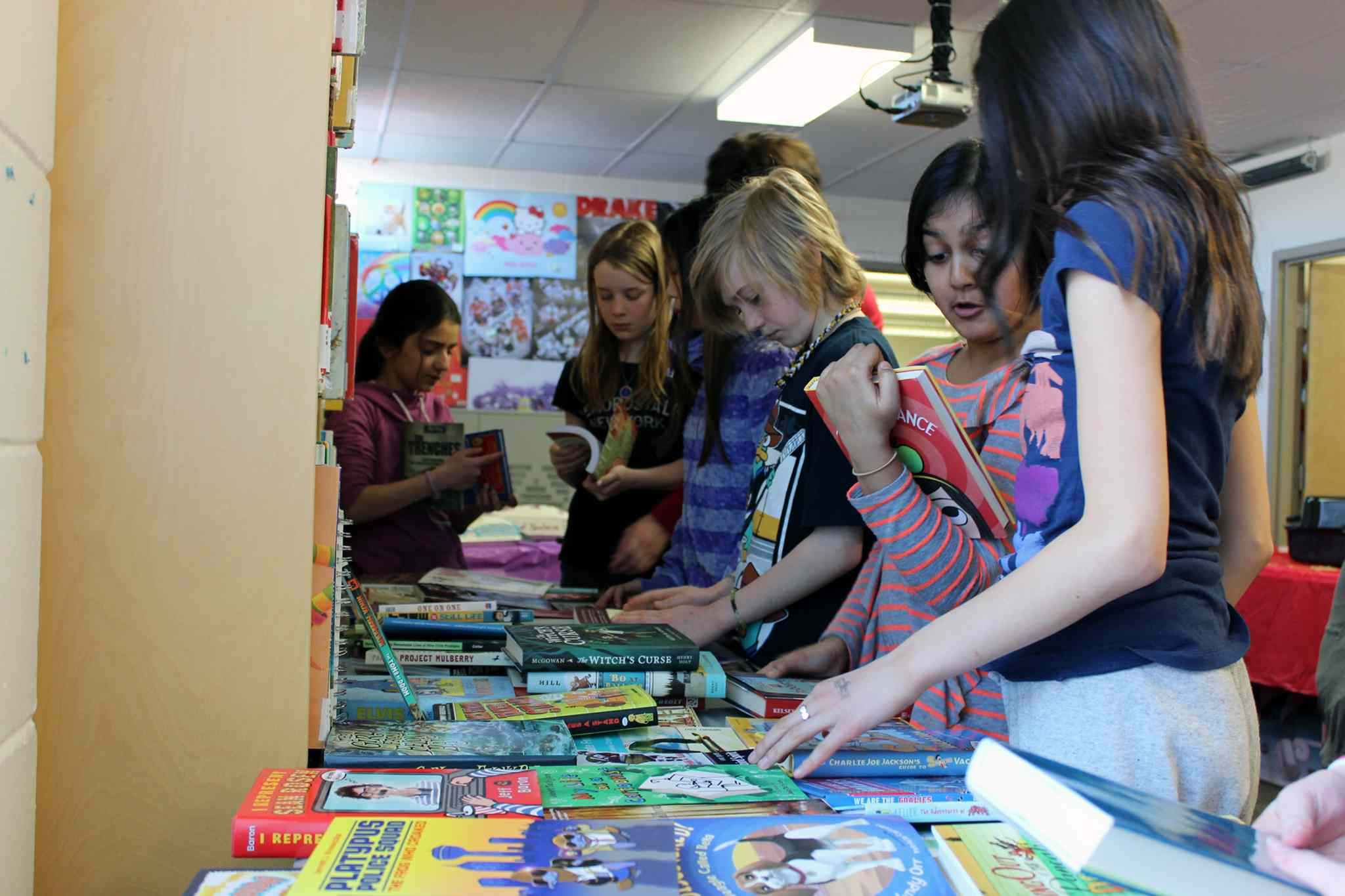 Payton Wareham, Anisha Sharma, and Kaleah Hoffman choose their new books.