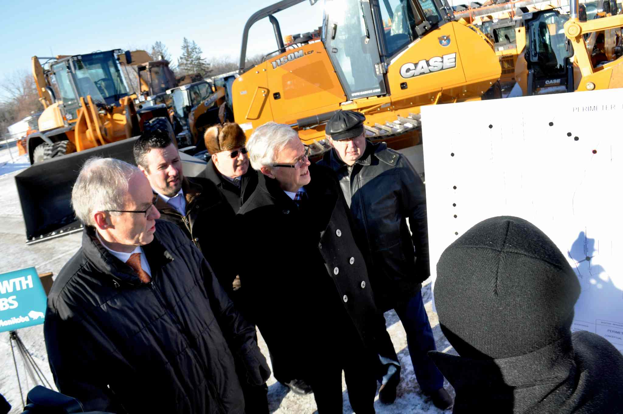 Premier Greg Selinger is joined by (l-r) Infrastructure and Transportation Minister Steve Ashton, MLA for St. Norbert Dave Gaudreau, Bob Dolyniuk of the Manitoba Trucking Association and Chris Lorenc of the Manitoba Heavy Construction Association.